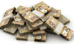 piles-de-billets-de-100-dollars-canadiens _manque à gagner non-reconnaissance des acquis